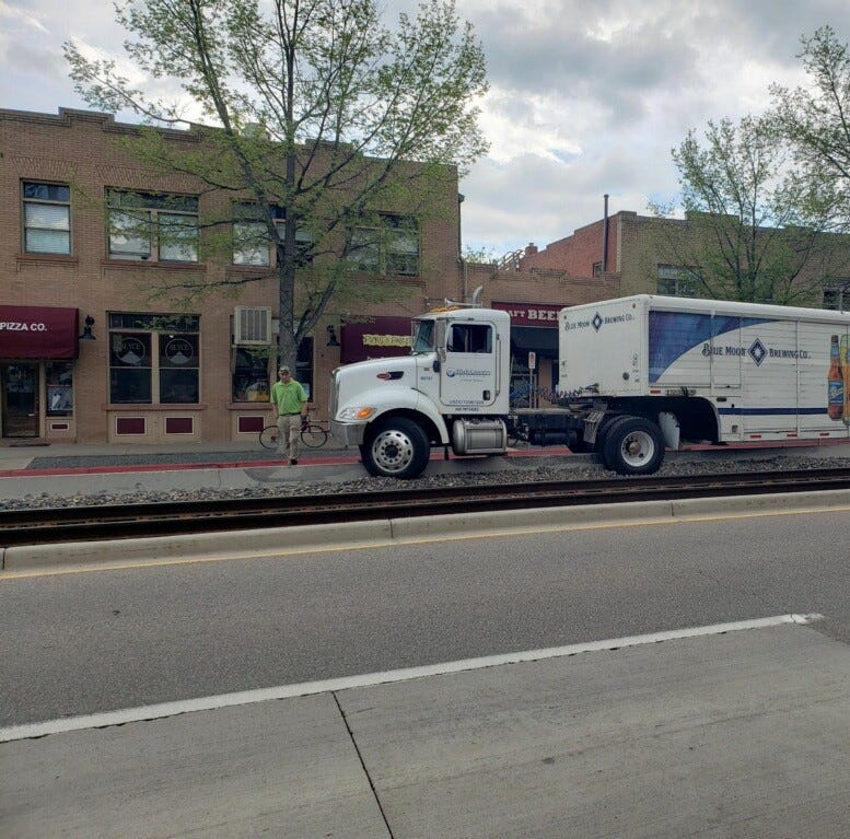 Traffic delayed after beer delivery truck gets stuck on train tracks near Old Town intersection