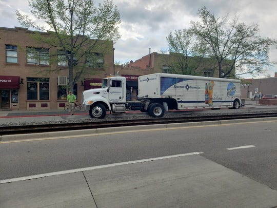 A Blue Moon Brewing Co. delivery truck is stuck in the train tracks on Mason Street just south of Mountain Avenue.