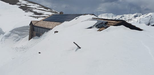 The Alpine Visitor Center and Trail Ridge Store is buried in snow in this photo taken late Wednesday by snowplow operators in Rocky Mountain National Park.