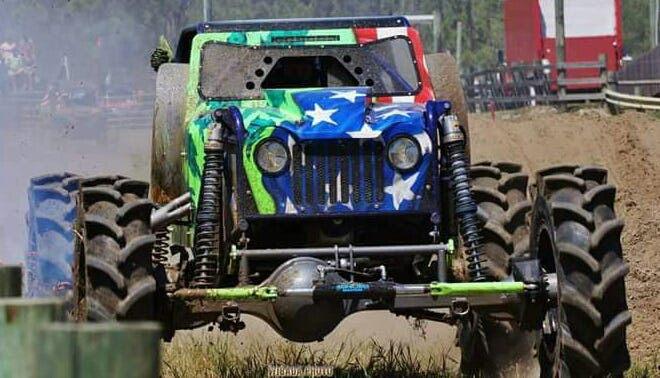 """Fort Myers mega-truck racer Chris Libak and his customized Jeep, Animalistic, c0-star in the new Discovery Channel show """"Dirty Mudder Truckers."""" Fort Myers airbrush artist Fred Shutrump did the truck's distinctive paintjob."""