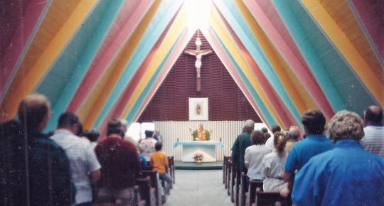 In a picture believed to have been taken Aug. 28, 1988, congregants attend a service at Guadalupe Chapel in Oconto.