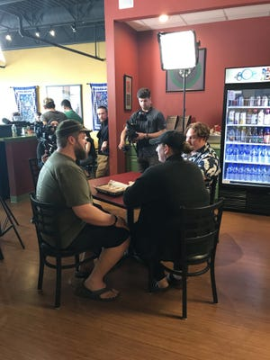 """Filming """"Man v. Food"""" at Eggrolls Inc. with show host Casey Webb, at right, in a Hawaiian shirt."""