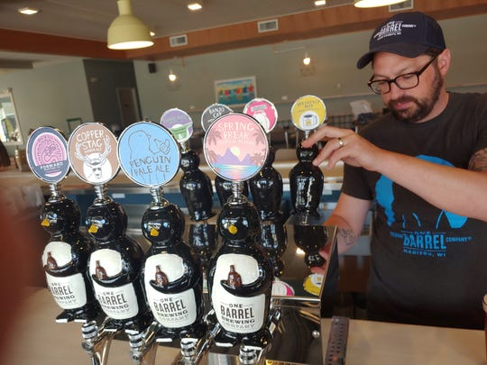 One Barrel Brewing Co. founder and president Peter Gentry pulls the tap handle to pour a beer in the craft brewery's tap room in Egg Harbor.