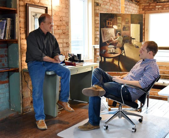 Artist Charles Pate, right, and his father Charlie Pate, who is also a Greenville-based artist talk together at their studio.