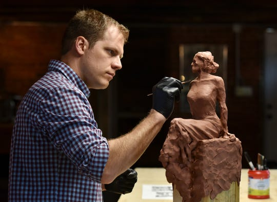 Artist Charles Pate works on a clay figure that will eventually be cast in bronze at The Pate Studio and Gallery in Greenville.