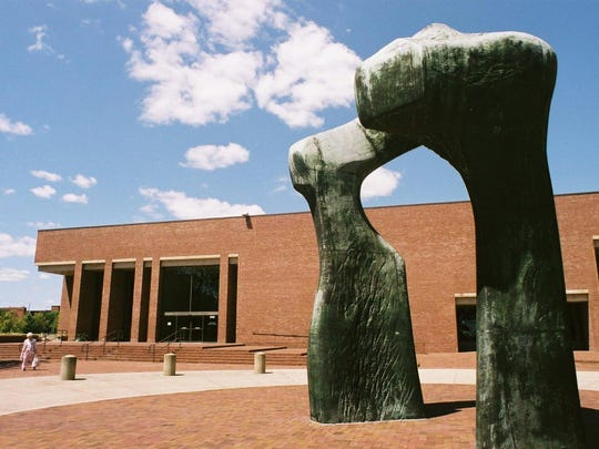 """I.M. Pei designed the Cleo Rogers Memorial Library in Columbus, Indiana. """"Large Arch,"""" a sculpture by Henry Moore, is seen in the foreground."""