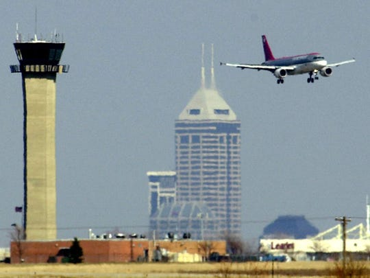 An air traffic control tower designed by I.M. Pei is seen at left in this 2000 photograph. The tower opened at Indianapolis International Airport in 1972 and was razed in 2006.