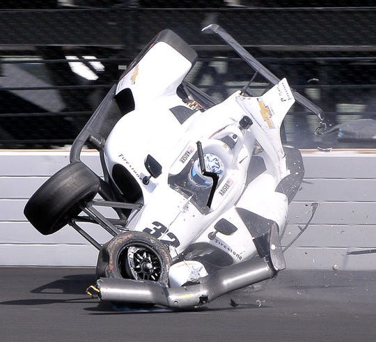 Kyle Kaiser (32) of Juncos Racing crashes after hitting the wall coming out of turn 3 during practice for the Indianapolis 500 at the Indianapolis Motor Speedway on Friday, May 17, 2019.