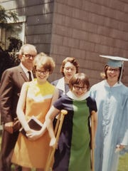 The Milams pose for a photo celebrating Charlene (Milam) Sanford's high school graduation in Richmond, Indiana, in 1967. Back row, from left: Charles, Helen, Charlene. Front, from left: Pamela and Sheila. Pamela was killed while walking on the Indiana State University campus five years later.