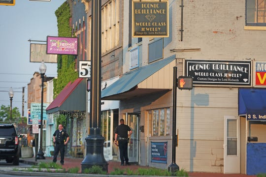 Mooresville Police stand outside Iconic Brilliance jewelry store in Mooresville on Thursday, May 16, 2019. Store owner Lora Richards faces nearly three dozen felony charges for theft, false appraisals and corrupt business practices.