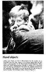 Jeffrey Lynn Hand, on trial in 1973 in Bloomington for the murder of an Evansville man in 1972, objects to his picture being taken by a Bloomington Herald-Telephone photographer.