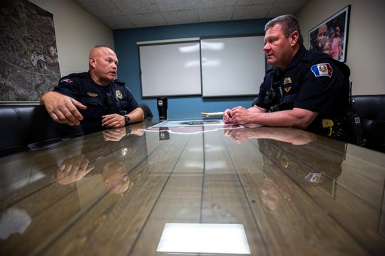 Coralville police officers Doug Carden, left, and Patrick McCoy talk, Friday, May 17, 2019, in the conference room at the Police Station in Coralville, Iowa