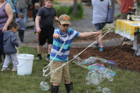 Families celebrate the 20th anniversary of Ithaca Children's Garden.