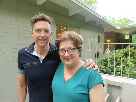Mark and Cathy Hill stand in front of their mid-century modern home on May 13, 2019.