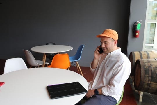 Daniel Hodge, SeatsOpen co-founder, on the phone with his Nashville-based business partner Miles Biggs.