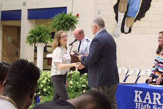 Lauren Kelly shakes principal Brad Corum's hand while receiving the Technology Student Association Leadership Award on Monday, May 6, 2019.