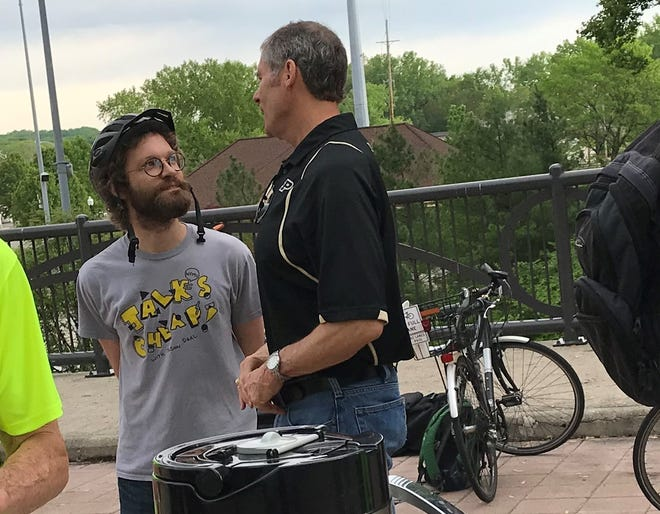 Zachary Baiel, left, talks with West Lafayette Mayor John Dennis during Bike to Work Day events Friday, May 17, 2019, on the John T. Myers Pedestrian Bridge. Baiel told Dennis on Friday that he intends to challenge him in the November municipal election. Baiel plans to run as an independent against Dennis, a Republican who had been uncontested in his bid for a fourth term in West Lafayette.