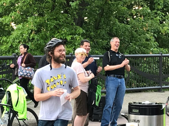 Zachary Baiel, left,  took part in Bike to Work Day events Friday, May 17, 2019, on the John T. Myers Pedestrian Bridge moments before telling West Lafayette Mayor John Dennis, right, that he intends to challenge him in the November municipal election. Baiel plans to run as an independent against Dennis, a Republican who had been uncontested in his bid for a fourth term in West Lafayette.