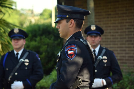 The Lafayette Police Department Honor Guard stands outside St. Barnabas Episcopal Church for a police memorial recognizing the 22 officers, deputies and troopers who were killed while on duty in Acadiana.
