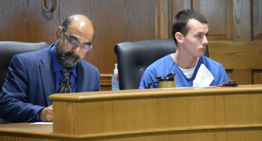 Corey Loar, 21, of Stoutsville, sits with his attorney Sanjay Bhatt at his plea and sentencing hearing May17.