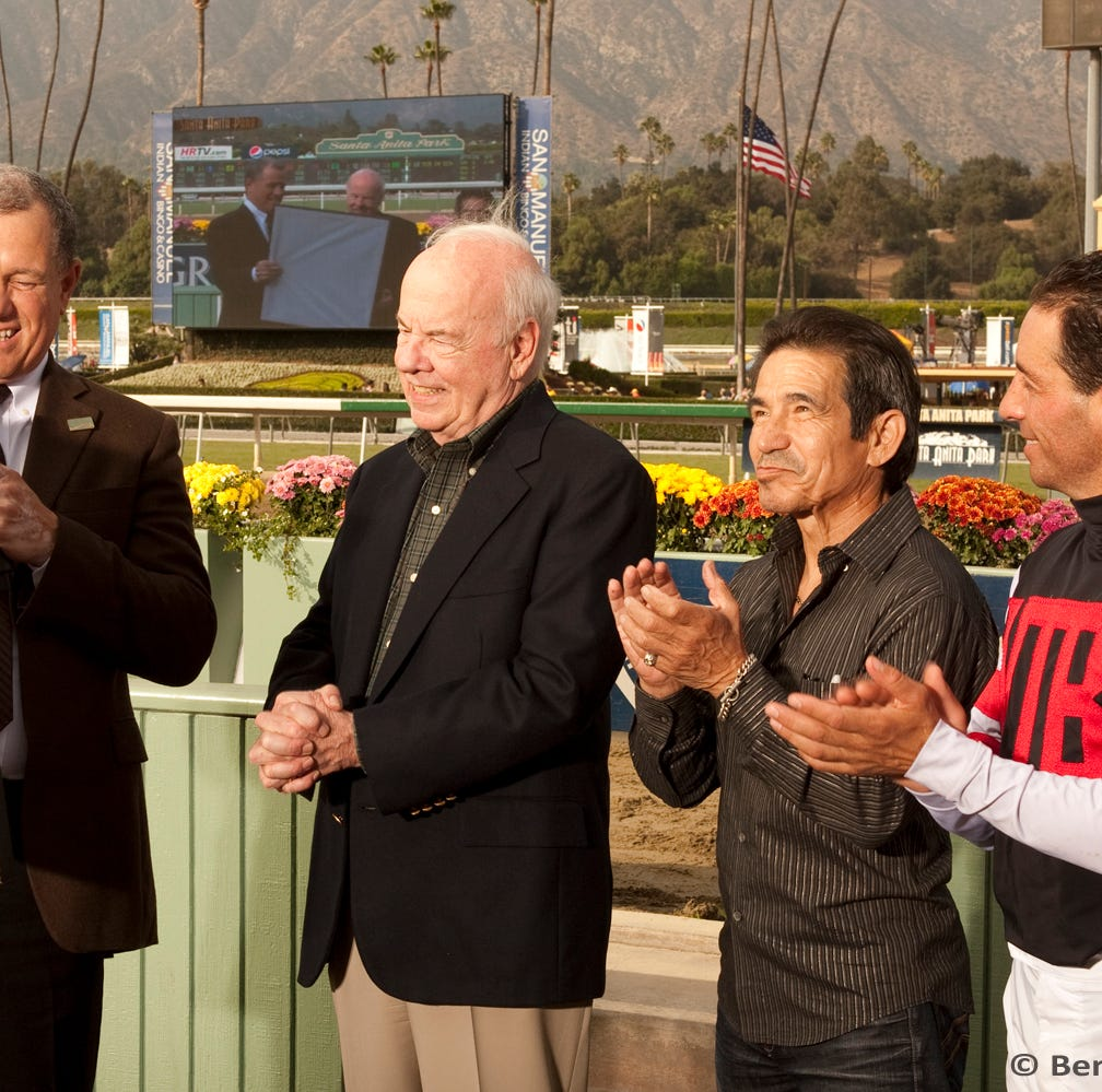 Tim Conway with jockeys Laffit Pincay Jr. and Aaron Gryderat at an event for the MacBeth Jockey Fun.