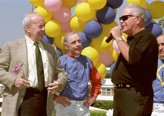 Jockey Chris McCarron, flanked by Tim Conway, left, and Gary Jones, retired trainer.