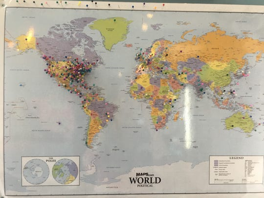 The world map inside Lynn Rhodea's Pearl Street Treats in Jeffersonville, Indiana, shows where customers are from when they visit her shop.