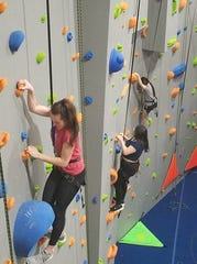 Manitowoc Lincoln senior Ava Swoboda climbs the new rock wall at Strand Adventures.