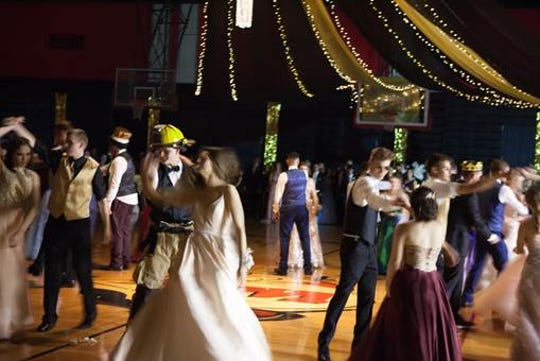 "Prom court members Zoe Dezeeuw, Gavin Stradal, Justin Steinbecker and Lucinda Kue swing dance to theme music from ""The Great Gatsby."""