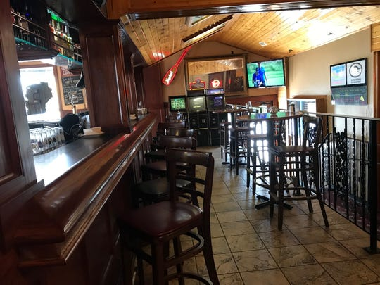 The bar area at Casa di Amici features dark wood and a few TV's for those who want to keep up with sports.
