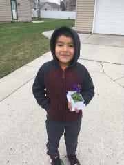 Elementary school students in the Manitowoc Public School District delivered homemade cards and flowers to neighbors on May Day.