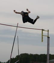 Colonel Crawford junior Alex Mutchler soared to a Division III district pole vault title by clearing 14 feet.