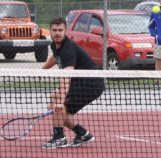 Clear Fork senior Noah Brown, shown here playing in last week's sectional finals, has become the first player in school history to qualify for the state tennis tournament.