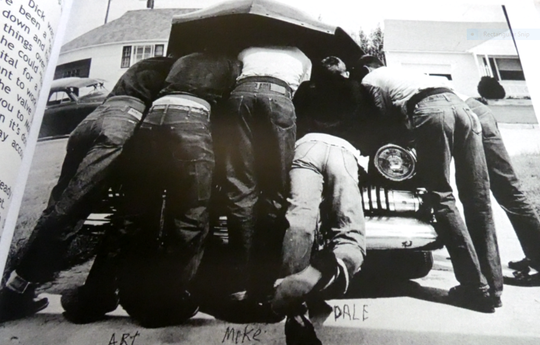 "A photograph from Dale Treace's book, ""The Life of an Auto Mechanic ""A Life of Service"" shows Treace, second from the right, working on a car with his buddies."