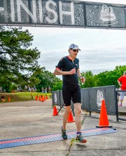 Tom Ratliff completes the 2018 Memphis in May Olympic triathlon. On Sunday, the 58-year-old doctor will race his third MIM Olympic triathlon after surviving a heart attack in 2011