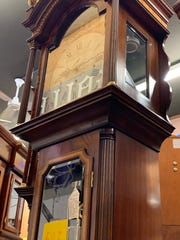 This grandfather clock, made by Bash Al-Rawass of Toronto, is one of the special pieces for sale at the Little Swiss Clock Shop that is available nowhere else in the area. Owner Karen White said the clockmaker dresses up his clocks with exquisite wood inlays and special materials. Like other merchandise, this clock is discounted as part of the store closing sale now underway.