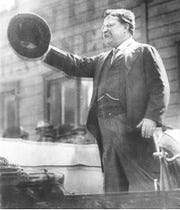 Teddy Roosevelt, speaking from a car in Milwaukee on Oct. 14, 1912, shorting before a gunman shot and wounded him.