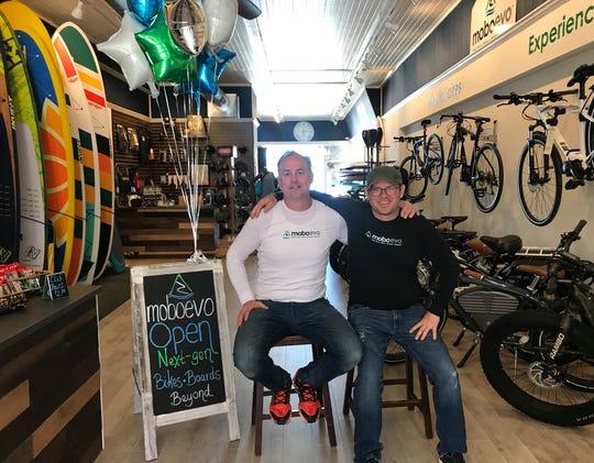Mark Radler (left) and Dan Hutter opened Moboevo in Oconomowoc in April.