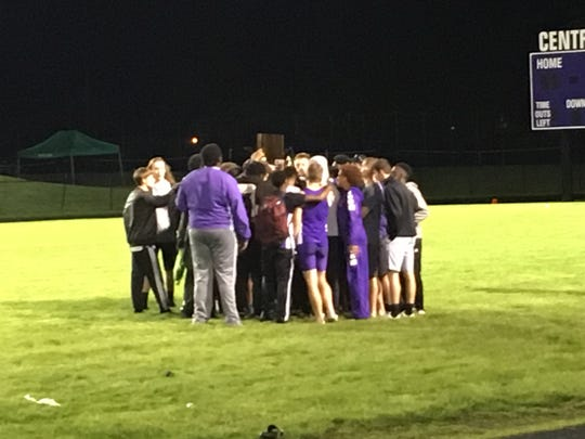 Muncie Central celebrates after its boys track and field sectional title win. The Bearcats beat the second-place Delta Eagles by one point.