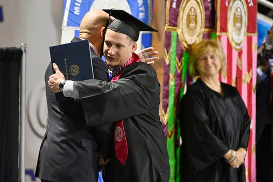 Combat veteran Jay Strobino, a Silver Star recipient, is congratulated at MTSU's December 2018 commencement by retired U.S. Army Lt. Gen. Keith Huber, the university's senior adviser for veterans and leadership initiatives. Huber aided Strobino in his pursuit of a degree from MTSU.