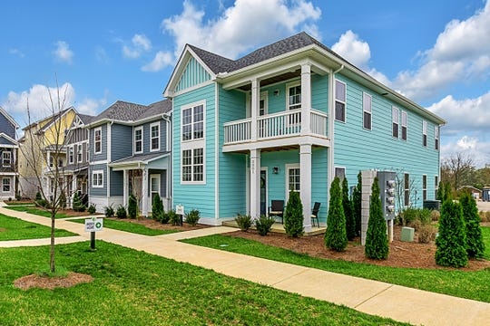 """The new model home is a light aqua blue that Waterford Village homeowner Kara Higney thinks of as """"almost beachy."""""""
