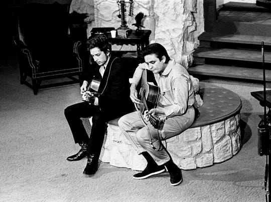 "Host Johnny Cash, right, rehearses the song ""Girl From the North Country"" with guest star Bob Dylan before taping ""The Johnny Cash Show"" at the Ryman Auditorium on May 1, 1969."
