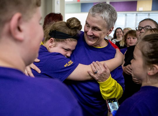 "Carson Elementary 5th grader Kyla Warner hugs her music teacher and choir director, Ann Robinson after Robinson directed her final concert with the school. Robinson is retiring after 39 years of teaching in Newark City Schools. ""She is so sweet and kind,:"" Warner said. ""She is a great person and inspires us everyday. She has so much love for everyone."""