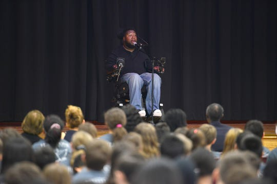 Eric LeGrand, a former Rutgers football player who is paralyzed, speaks to students at Fieldstone Middle School on Friday May 17, 2019 in Montvale, N.J.