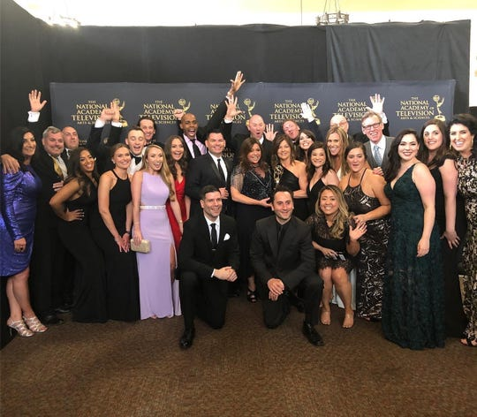 "The producers from ""The Rachael Ray"" show, including Ridgewood-resident Jeanette Donnarumma (far right) celebrate their Emmy Award win."