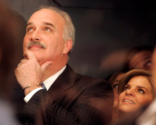 Former New York Rangers goaltender John Davidson, left, watches a presentation on the big screen with his wife, Diana, as he is honored before the New York Rangers play the St. Louis Blues Saturday, March 3, 2007 at Madison Square Garden in New York.  (AP Photo/Frank Franklin II)