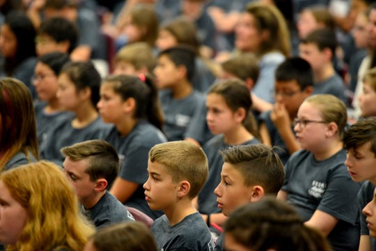 Students at Fieldstone Middle School listen to Eric LeGrand, a paralyzed former Rutgers football player, on Friday May 17, 2019 in Montvale, N.J.