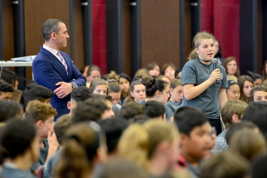 A students at Fieldstone Middle School asks a question to Eric LeGrand, a former Rutgers football player who is paralyzed, on Friday May 17, 2019 in Montvale, N.J.