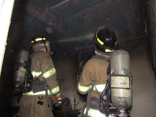 Las Cruces firefighters douse a blaze early Friday, May 17, 2019 in a home on Picacho Avenue. A woman suffered second- and third-degree burns in the fire.