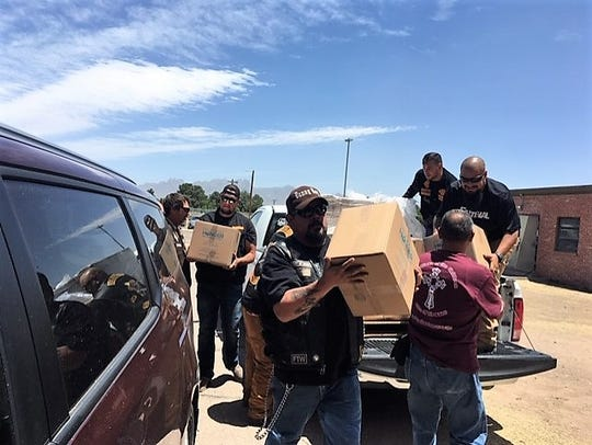 Volunteers unload non-perishable meals donated by Pack Away Hunger at the former U.S. Army Reserve Center in Las Cruces, where migrants released from federal custody are being processed. Friday, May 17, 2019.